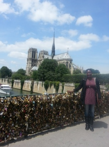 Lovers' Locks bridge with Notre Dame in the background.